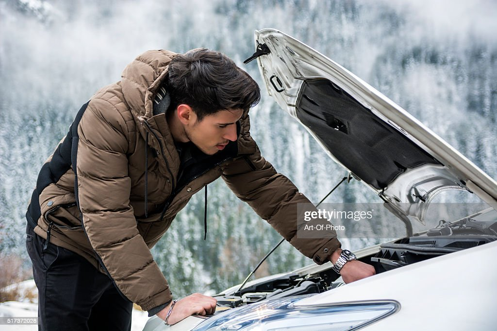 Man inspecting car engine : Stock Photo