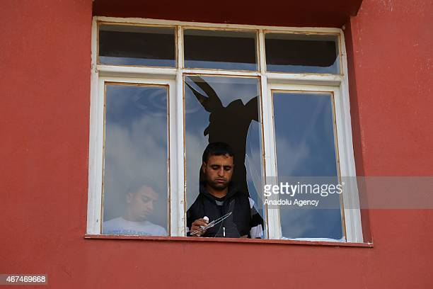 A man inspects a damaged house following an explosion in Reyhanli district of Hatay southern Turkey near TurkishSyrian border on March 25 2015 Two...