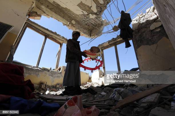 A man inspects a house of 11members from one family after it was hit by airstrikes carried out by the Saudiled coalition on Monday leaving the nine...