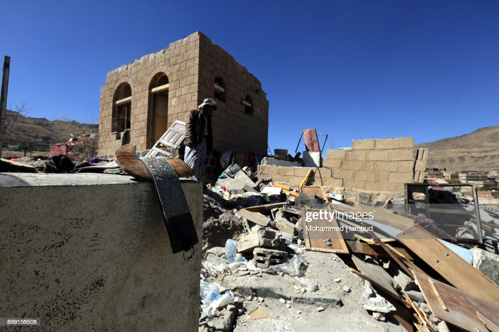 A man inspects a house of 11-members from one family after it was hit by airstrikes carried out by the Saudi-led coalition on Monday leaving the nine members including five children killed on December 26, 2017 in Sana'a, Yemen. The Houthi-run Saba news agency reported that at least 71 civilians, including 11 children, were killed in Yemen in 51 airstrikes carried out by the Saudi Arabia-led military coalition across the country over a 48-hour period.
