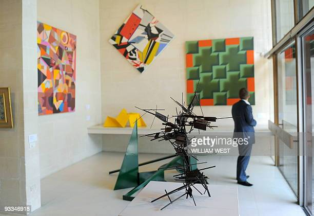 A man inspects an exhibition titled Cubism Australian Art at the Heide Museum of Modern Art a major exhibition that for the first time examines the...