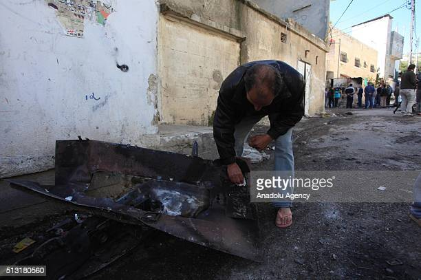 A man inspects damage on a street of Kalandia refugee camp after clashes between Israeli soldiers and Palestinians wounding 15 Israeli soldiers and...
