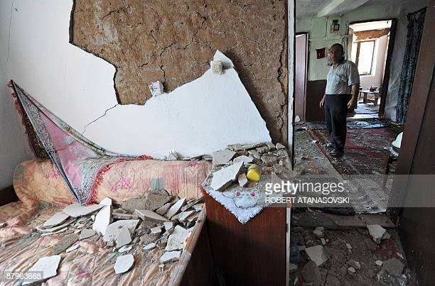 A man inspects his damaged house after his village of Basi Boz was hit by an earthquake near the town of Valandovo 160 km east of Skopje close to the...