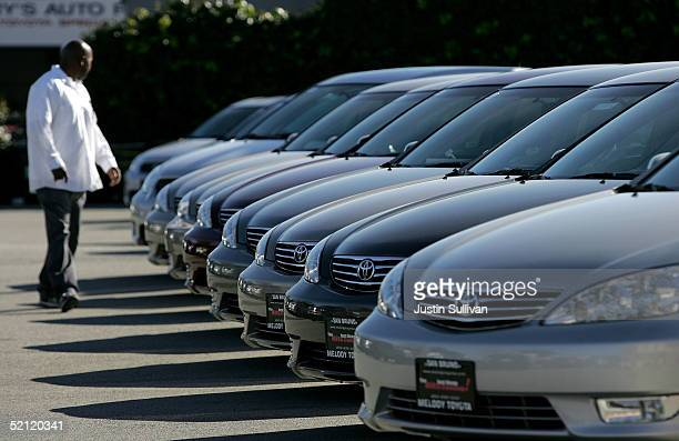 A man inspects new Toyota cars on display at Melody Toyota February 1 2005 in San Bruno California Toyota and Nissan reported healthy gains in their...