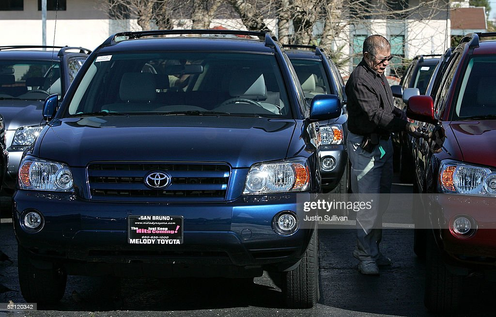 A Man Inspects New Toyota Cars On Display At Melody Toyota February 1 2005  In San