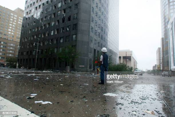 A man inspects the damage in front of the JP Morgan Chase Tower after Hurricane Ike passed through the city September 13 2008 in Houston Texas...