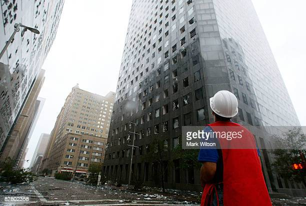 A man inspects the damage in front of the JP Morgan Chase Tower after Hurricane Ike past through the city September 13 2008 in Houston Texas...