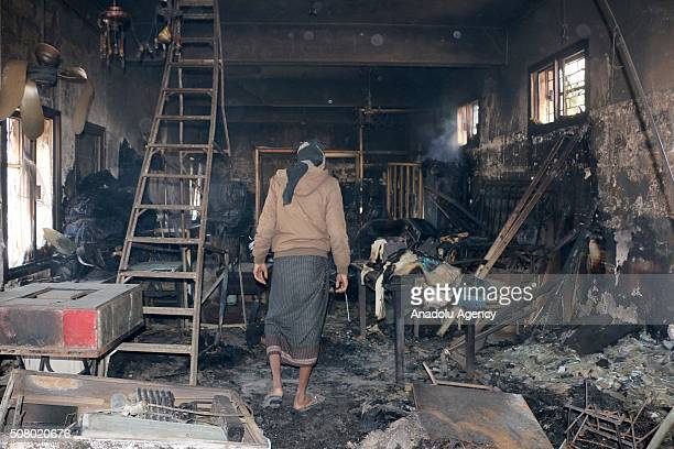 Man inspects the fire site at the Taiz National Museum, under the control of Popular Resistance Forces, after it was hit by Houthi shellings in Taiz,...