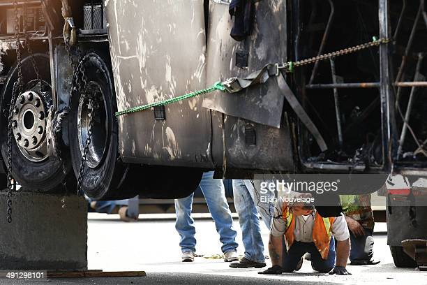 A man inspects the remains of a bus involved in a deadly collision at the CalTrans Maintenance Yard on April 11 2014 in Willows California Ten people...