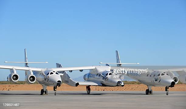 Man inspects WhiteKnightTwo, which carries SpaceShipTwo, prior to a flight at Spaceport America, northeast of Truth Or Consequences, on October 17,...
