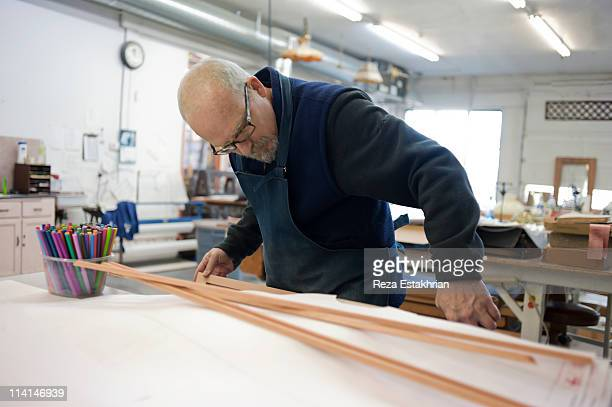 Man inspects wood for craft project