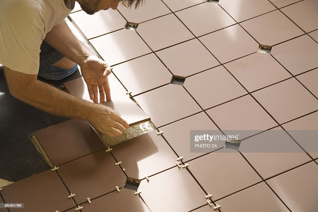 Man Installing Floor Tile Stock Photo Getty Images