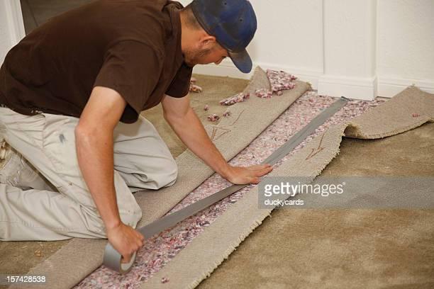 Man Installing New Carpet