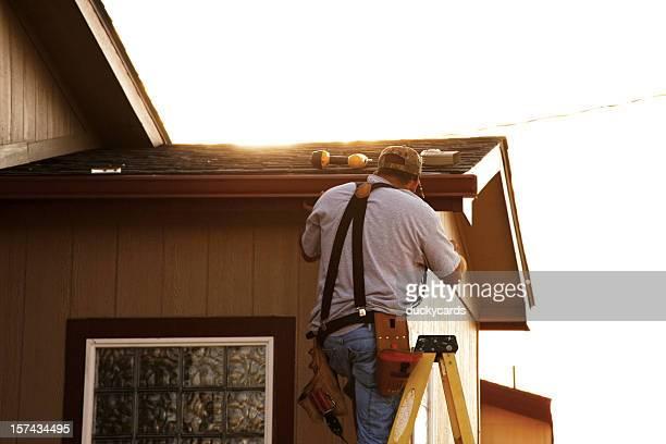 Man Installing Seamless Gutters