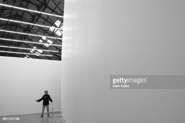 A man interacts with the artwork 'Constellations' by artist Marco Fusinato which is part of the 31st Biennale of Sydney at Carriage Works on March 13...