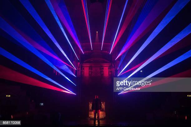 A man interacts with the illuminated art installation entitled 'On Your Wavelength' in Leeds Town Hall which features in the annual 'Light Night...