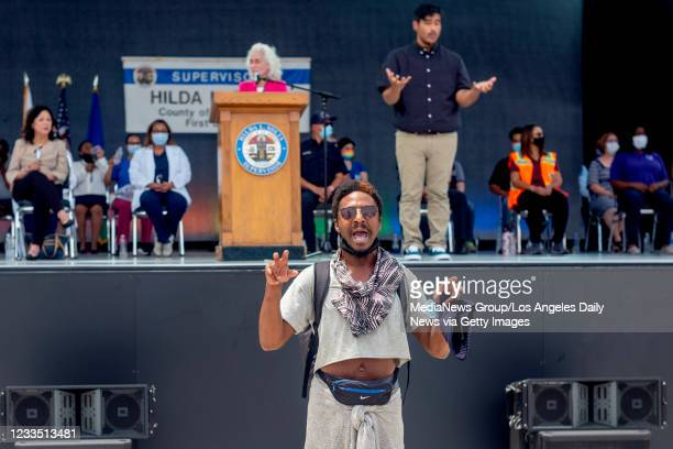 Man interrupts Dr. Barbara Ferrer, director of the L.A. County Department of Public Health during a press conference at the Music Center Plaza in Los...