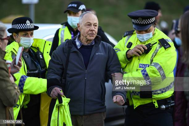 Man is arrested as anti-lockdown protestors hold a demonstration Ceilidh outside the Scottish Parliament on November 28, 2020 in Edinburgh, Scotland....