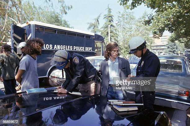 Man is arrested by Los Angeles Police officers during a student protests against Nixon foreign policies involving the Vietnam war, circa 1970's at...
