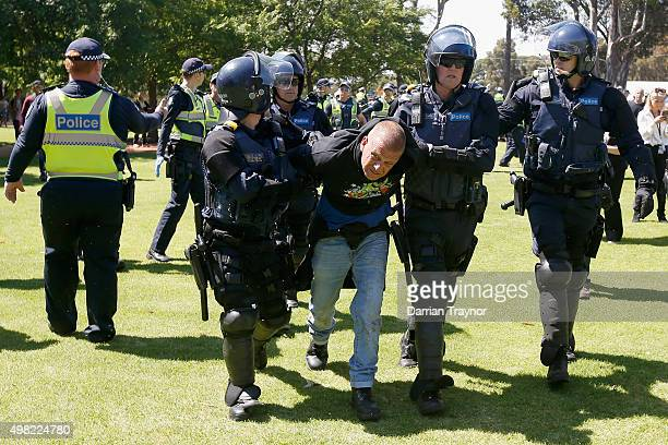 A man is arrested by police during a Reclaim Australia rally held in Melton on November 22 2015 in Melbourne Australia Protestors gathered near the...