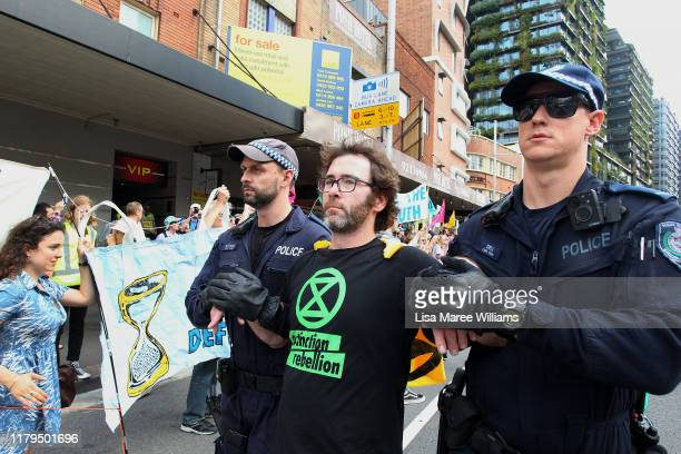 A man is arrested by police during an Extinction Rebellion protest in the Sydney Central Business District on October 07 2019 in Sydney Australia The...