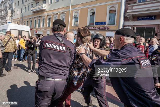 A man is arrested by riot police in a demonstration against Putin in Pushkin square Moscow Russia on 5 May 2018