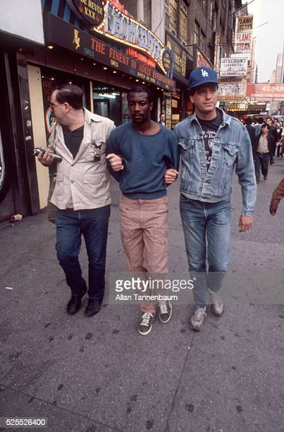 A man is arrested by undercover NYPD for selling crack cocaine on 42nd St in Times Square New York New York June 16 1986