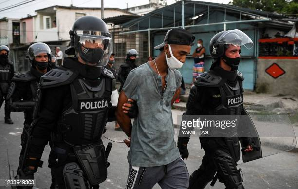 Man is arrested during a demonstration against the government of President Miguel Diaz-Canel in Arroyo Naranjo Municipality, Havana on July 12, 2021....