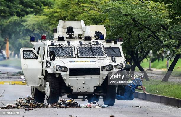 A man is arrested during clashes between antigovernment activists and the National Guard in Venezuela's third city Valencia on August 6 a day after a...