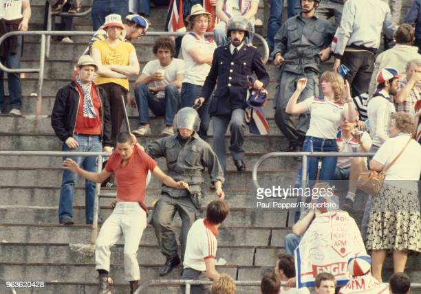 Man is arrested following crowd trouble during the UEFA Euro 1980 group game between Belgium and England at the Stadio Olimpico Grande Torino on June...