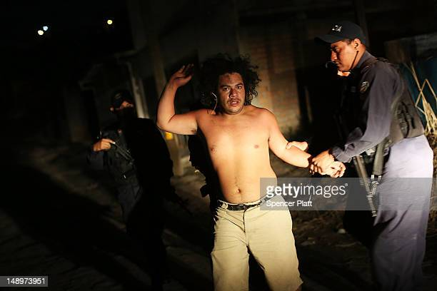 A man is arrested for fighting in a neighborhood with heavy gang violence on July 20 2012 in Tegucigalpa Honduras Honduras now has the highest per...