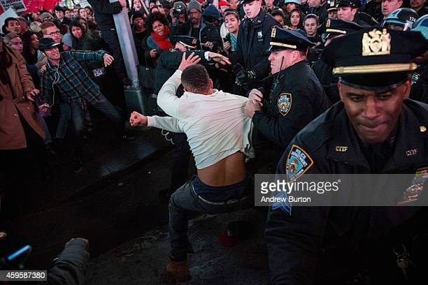 Man is arrested in Times Square by police while protesting the Ferguson grand jury decision to not indict officer Darren Wilson in the Michael Brown...