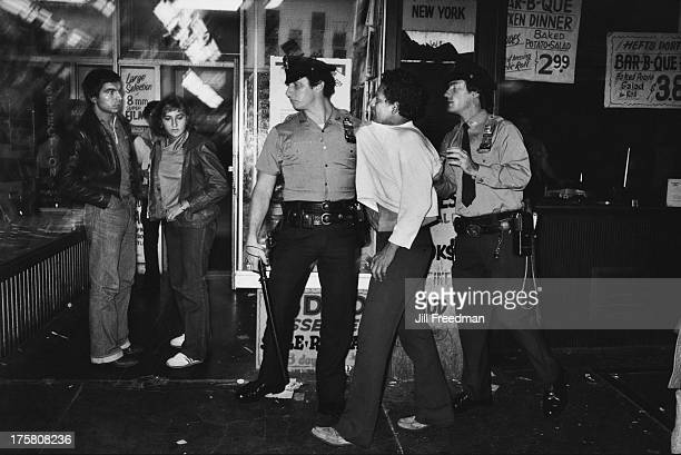 A man is arrested on 42nd Street by two police officers New York City 1979