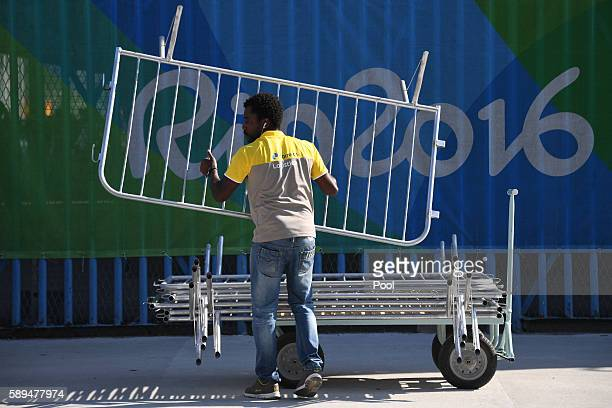 Man is at work in the starting area ahead of the Women's Marathon during the athletics event at the Rio 2016 Olympic Games at Sambodromo in Rio de...