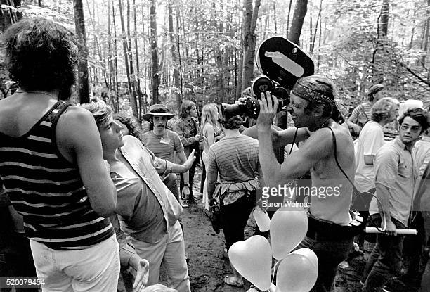 A man is being filmed by a cameraman at the Woodstock Music Art Fair celebrated in Bethel NY August 15 1969