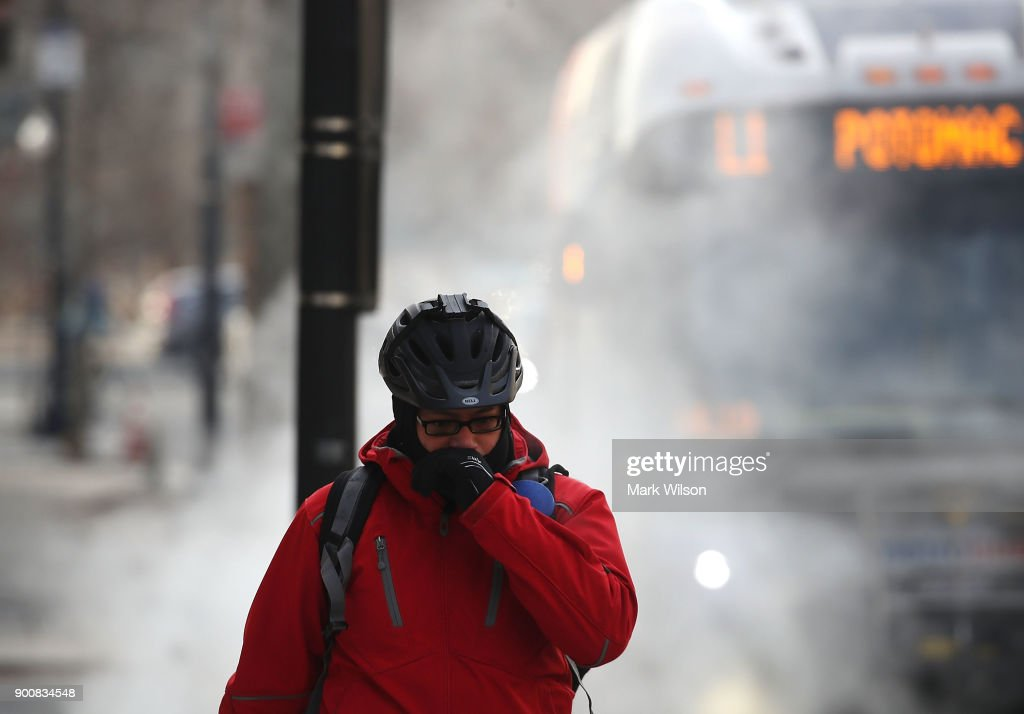 A man is bundled up as he walks past a steam grate on January 3, 2018 in Washington, DC. A winter storm is traveling up the east coast overnight with significant accumulations of snow possible.