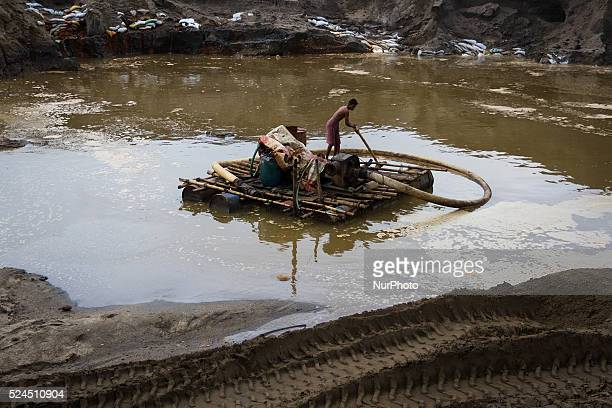 A man is carrying his shallow machine from one side of the site to other site inside a stone extraction site on April 4 2015 in Jaflong Sylhet...