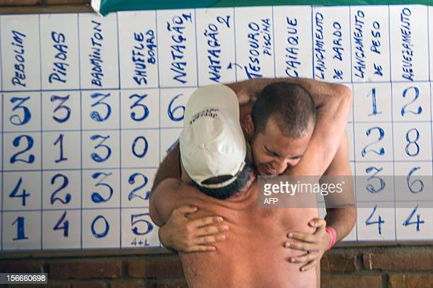 A man is congratulated as he receives a silver medal during the first Brazilian Naturist Olympics in Guaratingueta about 200 km east of Sao Paulo...
