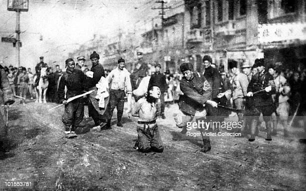A man is decapitated during an execution in the street China circa 1930