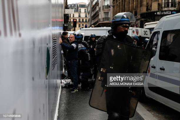 A man is detained by police during a 'Yellow Vest' antigovernment protest on December 22 in Paris as part of a nationwide day of demonstrations Three...