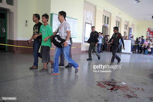 A man is detained by police near the explosion area at Hua Lamphong train station in Bangkok A small explosion at Bangkok's Hua Lamphong train...