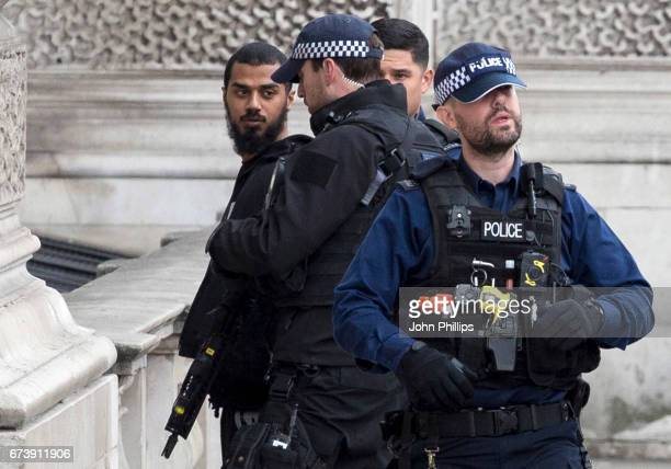 A man is detained by police officers near Downing Street on Whitehall on April 27 2017 in London England Multiple knives were seen at the scene close...