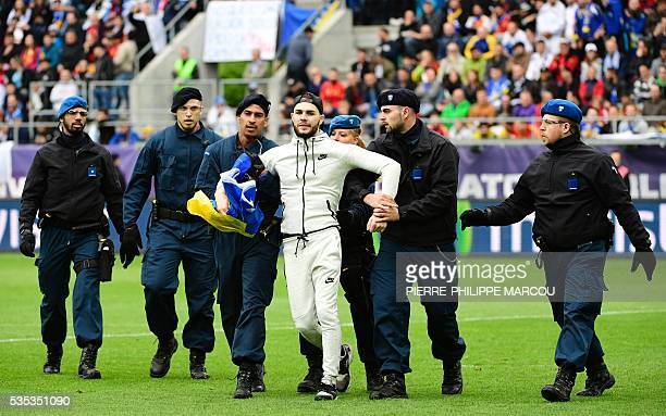A man is detained by the stadium security during the friendly football match between Spain and Bosnia and Herzegovina at the AFG Arena in St Gallen...