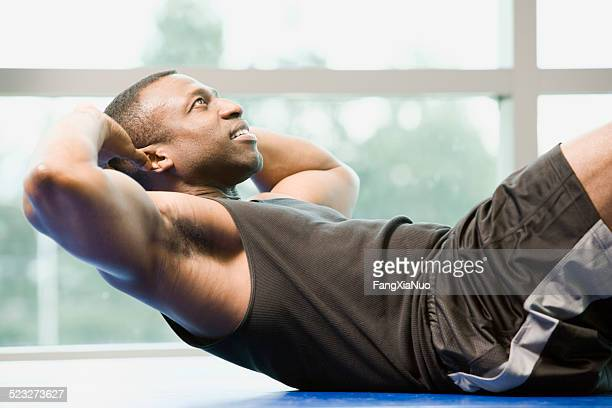 Man Is Doing Sit-Ups At A Gym