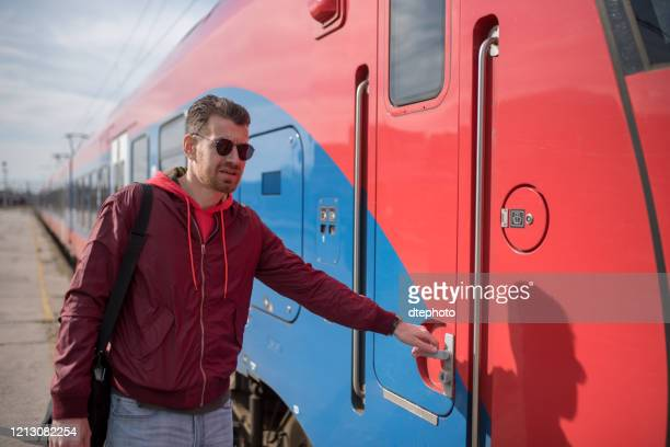 man is entering the train - men fashion stock pictures, royalty-free photos & images