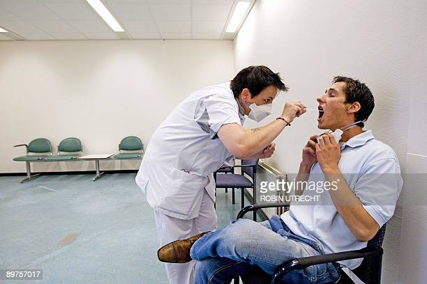 A man is examined for Swine flu the new A at the polyclinic in the Slotervaart Hospital that opened today in Amsterdam on August 12 2009 The clinic...
