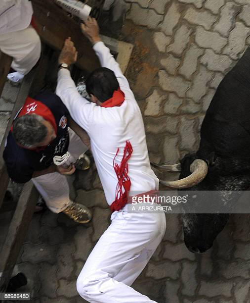 A man is gored by a Miura fighting bull during the sixth run of the bulls of the San Fermin festival on July 12 in Pamplona northern Spain The...