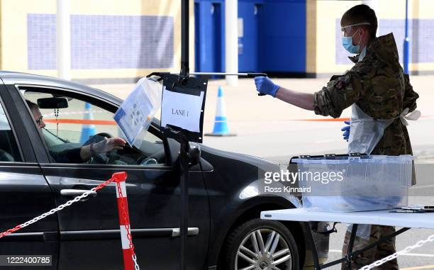 A man is handed testing equiptment in his car at the Coronavirus Covid19 testing centre at Leicester City's King Power Stadiun on May 02 2020 in...