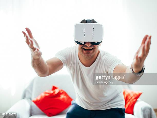 man is happy in virtual world - south_agency stock pictures, royalty-free photos & images