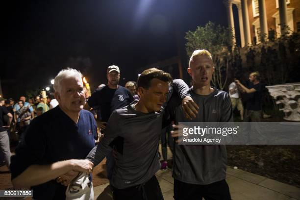 A man is helped after being hit in the face with pepper spray during a clash between counter protestors and Neo Nazis AltRight and White Supremacist...